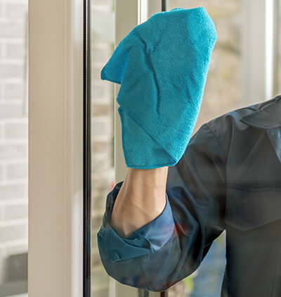 Man cleaning the window glass